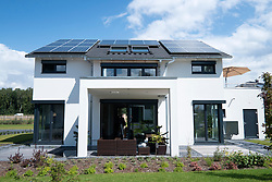 Modern highly energy efficient family house with solar panels on roof in Germany