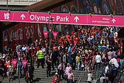 Aerial view of spectator crowds at the Westfield City shopping complex, Stratford that leads to the Olympic Park during the London 2012 Olympics, the 30th Olympiad. Large Coca-Cola ads line the walkway to the Olympic Park. Situated on the fringe of the 2012 Olympic park, Westfield is Europe's largest urban shopping centre. The £1.45bn complex houses more than 300 shops, 70 restaurants, a 14-screen cinema, three hotels, a bowling alley and the UK's largest casino. It provides the main access to the Olympic park with a central 'street' giving 75% of Olympic visitors access to the main stadium so retail space.