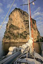 Asia, Thailand, Southern Thailand, Phang Nga Bay, Sailboat and karst (limestone) island with hanging gardens and stalactites