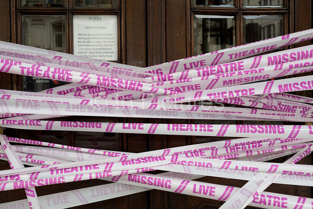 The UK government has announced a Coronavirus pandemic financial rescue package for the Arts industry, a £1.15bn support for cultural organisations in England which is made up of £880m in grants and £270m of repayable loans. But venues such as The Apollo Theatre on Shaftesbury Avenue in Londons West End Theatreland, where the musical Jamie was abandoned at the beginning of lockdown, will remain closed for the foreseeable future, on 6th July 2020, in London, England. Some theatres in London and others around the country have been wrapped in bright pink barrier tape, which reads Missing Live Theatre -  a protest project led by stage designers group Scene Change highlighting the closure of the arts and culture arts industry supports 137,250 jobs and is worth £21.2bn in direct turnover.