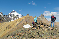 Hikers en route to summit of Parker Ridge, Mount Atahbasca is in the distance, Banff National Park Alberta Canada