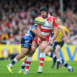 Gareth Evans (Gloucester) offloads the ball after being tackled - Photo mandatory by-line: Patrick Khachfe/JMP - Tel: Mobile: 07966 386802 12/04/2014 - SPORT - RUGBY UNION - Kingsholm Stadium, Gloucester - Gloucester Rugby v Bath Rugby - Aviva Premiership.