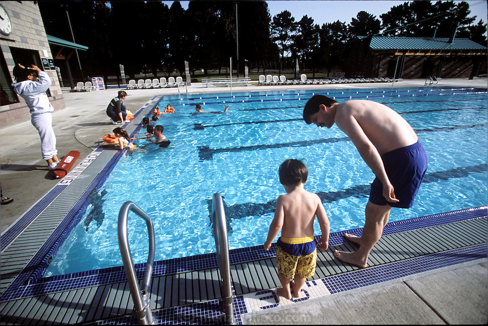 Craig Caven spends a moment with his son Ryan at the shallow end of the local American Canyon, California swimming pool. (Supporting image from the project Hungry Planet: What the World Eats.)