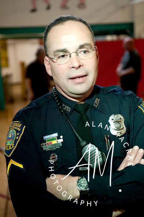 Laconia Police Officer Don Kimtis reflects on his career with the Laconia Police Department with for reporters after being named the 2008 recipient of the City's Employee of the Year award.  (Alan MacRae/for the Laconia Daily Sun)