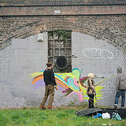 London,England,UK : 11th April 2016 : 'Endangered 13' Project, street artists continue painting live animal raising awareness Endangered animal at Ackroyd Drive, Sponsor by Tower Hamlets council in London. Photo by See Li