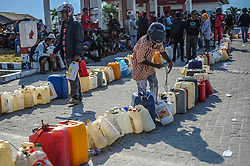 October 3, 2018 - Palu, Central Sulawesi, Indonesia - Residents seen lining up to buy fuel in the Tondo gas station, They have to queue for up to 12 hours to get it..A deadly earthquake measuring 7.7 magnitude and the tsunami wave caused by it has destroyed the city of Palu and much of the area in Central Sulawesi. According to the officials, death toll from devastating quake and tsunami rises to 1,347, around 800 people in hospitals are seriously injured and some 62,000 people have been displaced in 24 camps around the region. (Credit Image: © Hariandi Hafid/SOPA Images via ZUMA Wire)