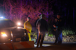October 29, 2019, Kellogg, CA, USA: Law enforcement officer question man a checkpoint on Chaulk Hill Road near Windsor during the Kincade fire on Tuesday, October 29, 2019 in Windsor. The Kincade Fire has burned 75,415 acres and is 15% contained. (Credit Image: © Paul Kitagaki Jr./ZUMA Wire)