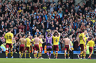 Burnley players celebrate with their fans at the final whistle the Sky Bet Championship match between Brighton and Hove Albion and Burnley at the American Express Community Stadium, Brighton and Hove, England on 2 April 2016.
