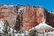 Spring snow coats red sandstone and melts into a waterfall along West Rim Spring and the West Rim Trail, Zion National Park, Springdale, Utah, USA. The North Fork of the Virgin River carved spectacular Zion Canyon through reddish and tan-colored Navajo Sandstone up to half a mile (800 m) deep and 15 miles (24 km) long. Uplift associated with the creation of the Colorado Plateaus lifted the region 10,000 feet (3000 m) starting 13 million years ago. Zion and Kolob canyon geology includes 9 formations covering 150 million years of mostly Mesozoic-aged sedimentation, from warm, shallow seas, streams, lakes, vast deserts, and dry near-shore environments. Mormons discovered the canyon in 1858 and settled in the early 1860s. U.S. President Taft declared it Mukuntuweap National Monument in 1909. In 1918, the name changed to Zion (an ancient Hebrew name for Jerusalem), which became a National Park in 1919. The Kolob section (a 1937 National Monument) was added to Zion National Park in 1956. Unusually diverse plants and animals congregate here where the Colorado Plateau, Great Basin, and Mojave Desert meet.