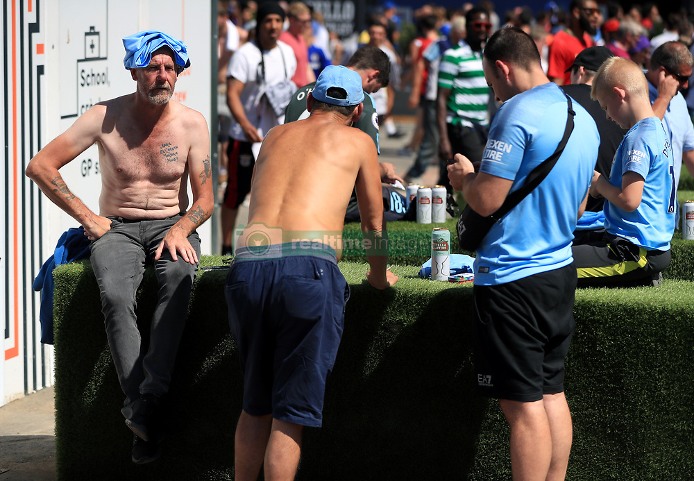 """Manchester City fans outside the ground before the Community Shield match at Wembley Stadium, London. PRESS ASSOCIATION Photo. Picture date: Sunday August 5, 2018. See PA story SOCCER Community Shield. Photo credit should read: Mike Egerton/PA Wire. RESTRICTIONS: EDITORIAL USE ONLY No use with unauthorised audio, video, data, fixture lists, club/league logos or """"live"""" services. Online in-match use limited to 75 images, no video emulation. No use in betting, games or single club/league/player publications."""