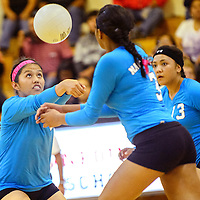 102314  Adron Gardner/Independent<br /> <br /> Navajo Prep Eagle Jazmin Benally (14), left, lines up a reverse volley to the Crown point Eagles in Crownpoint Thursday.