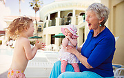 Grandmother with Granddaughters in Pool