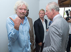 The Prince of Wales (right) talks to Sir Richard Branson (left) who lost his home in Hurricane Irma, as he attends a community reception at Government House in The British Virgin Islands, as he continues his tour of hurricane-ravaged Caribbean islands.