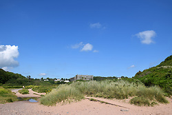 Manorbier beach with castle behind, Pembrokeshire, South Wales, July 2021