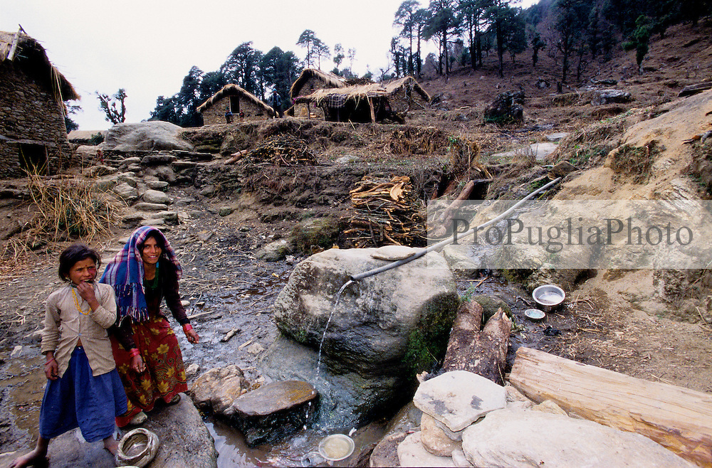 Dailekh, 04 March 2005. .. Villagers washing their dishes.