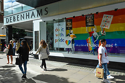 © Licensed to London News Pictures. 01/07/2019. LONDON, UK.  The Debenhams department store on Oxford Street is one of many retail stores in the capital's West End whose exteriors are decorated in rainbow colours in support of Pride Month.  Pride is an annual celebration of the LGBT+ community and culminates in the LGBT+ parade in the UK, with thousands of people travelling the route either by foot or on floats.  Photo credit: Stephen Chung/LNP