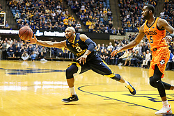 Feb 10, 2018; Morgantown, WV, USA; West Virginia Mountaineers guard Jevon Carter (2) attempt to grab a rebound late in the second half against the Oklahoma State Cowboys at WVU Coliseum. Mandatory Credit: Ben Queen-USA TODAY Sports