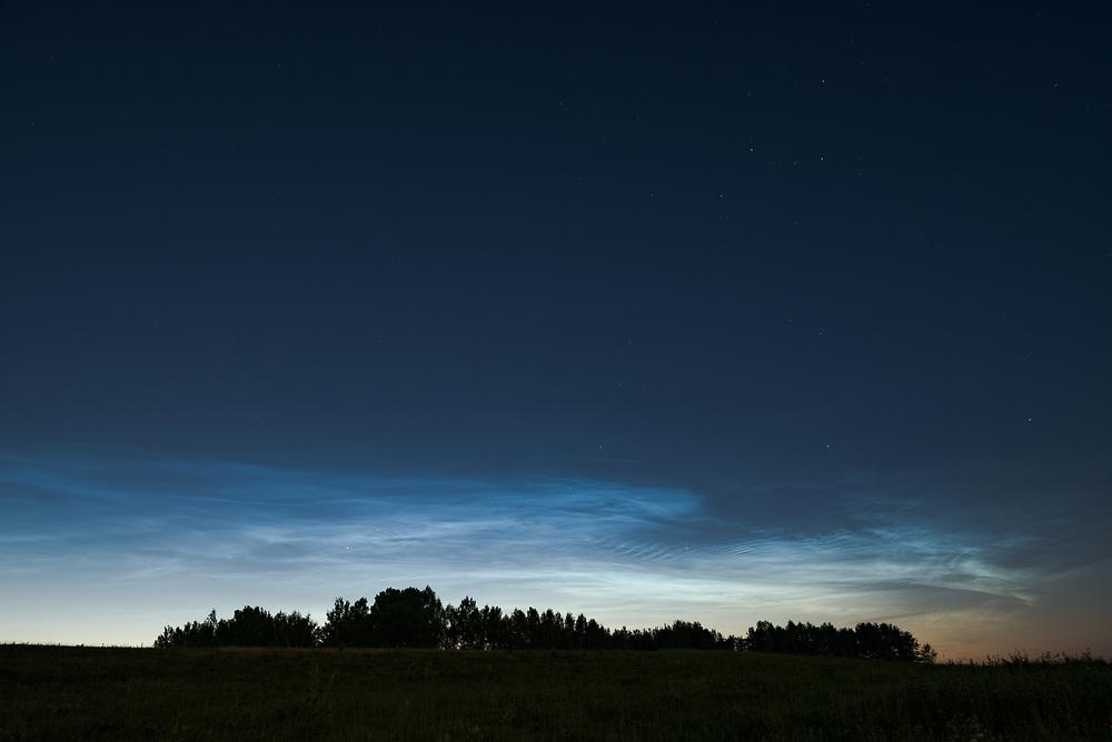 "A group of noctilucent clouds in summer night, nature park ""Dvietes paliene"", Latvia Ⓒ Davis Ulands | davisulands.com"