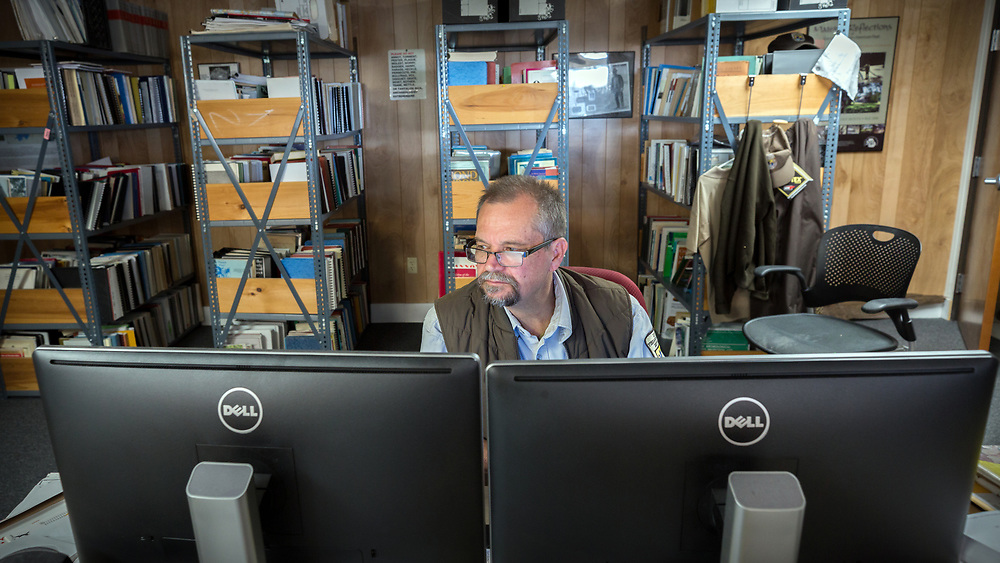 BLUFFTON, S.C. - FEBRUARY 20, 2018:<br /> Rick Kanaski, Regional Archaeologist & Regional Historic Preservation Officer for the U.S. Fish and Wildlife Service, works at his desk in the Savannah National Wildlife Refuge. (WABE Photo/Stephen B. Morton)