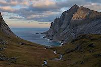 A small stream flows through Trolldalen valley above Bunes beach, Moskenesøy, Lofoten Islands, Norway