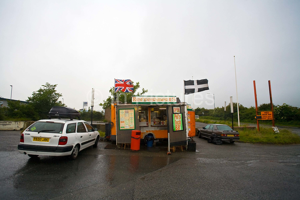 A roadside burger van with a Union Jack and the Cornish flag on 21st June 2008 in Victoria in the United Kingdom.