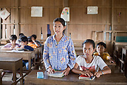 15 MARCH 2006 - PEAM CHIHYKAUNG, KAMPONG CHAM, CAMBODIA: Girls in a private English language school near the village of Peam Chihykaung along the Mekong River in central Cambodia. Schools and education, which the Khmer Rouge abolished, are important in modern Cambodia. Girls and boys alike go to school, even in small rural communities through elementary school and high school in larger towns. PHOTO BY JACK KURTZ