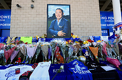"""Supporters pay tribute at Leicester City Football Club. Leicester Chairman, Vichai Srivaddhanaprabha, was among those to have tragically lost their lives on Saturday evening when a helicopter carrying him and four other people crashed outside King Power Stadium. PRESS ASSOCIATION Photo. Picture date: Monday October 29, 2018. Broken-hearted Leicester have paid tribute to """"a great man"""" following the death of billionaire owner Vichai Srivaddhanaprabha in a helicopter crash close to the King Power Stadium. See PA story SOCCER Leicester Stadium. Photo credit should read: Mike Egerton/PA Wire"""