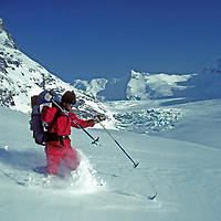 Ski mountaineer Jay Jensen makes turns in knee deep powder below 16,000 foot Warwan Pass during a pioneering two-week ski expedition across India's Great Himalaya Range, from Ladakh to Kashmir.