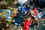 Family sleep on the ground using a life jacket as a pillow in Kara Tepe camp in Lesvos island, Greece, Aug 13th, 2015.