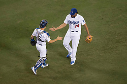 October 31, 2017 - Los Angeles, CA, USA - The Los Angeles Dodgers' Austin Barnes and Kenley Jansen celebrate after the Dodgers' 3-1 victory over the Houston Astros in Game Two of the World Series at Dodger Stadium in Los Angeles, CA on Tuesday, October 31, 2017. (Credit Image: © Kevin Sullivan/Los Angeles Daily News via ZUMA Wire)