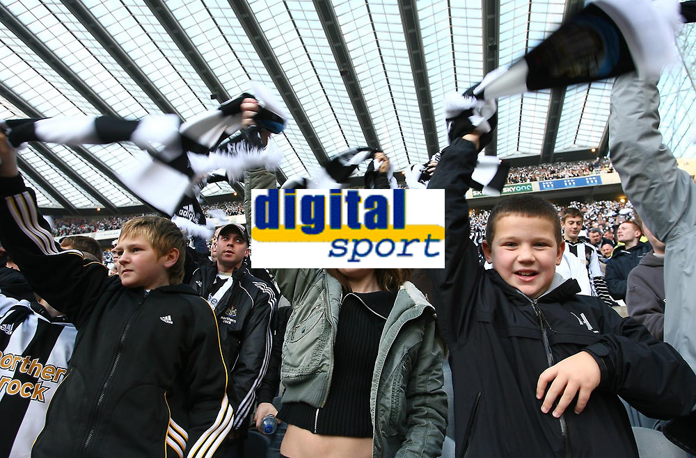 Photo: Andrew Unwin.<br /> Newcastle United v Portsmouth. The Barclays Premiership. 26/11/2006.<br /> Newcastle fans wave black and white scarves before the game.