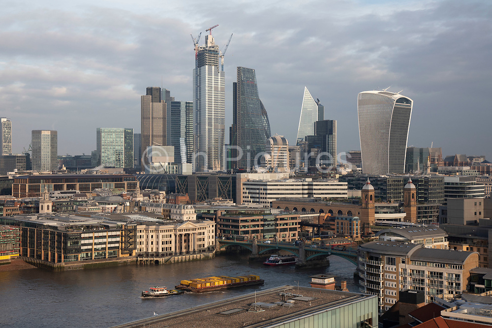 Cityscape skyline view over the River Thames and rooftops and River Thames towards the financial district of the City of London, England, United Kingdom.