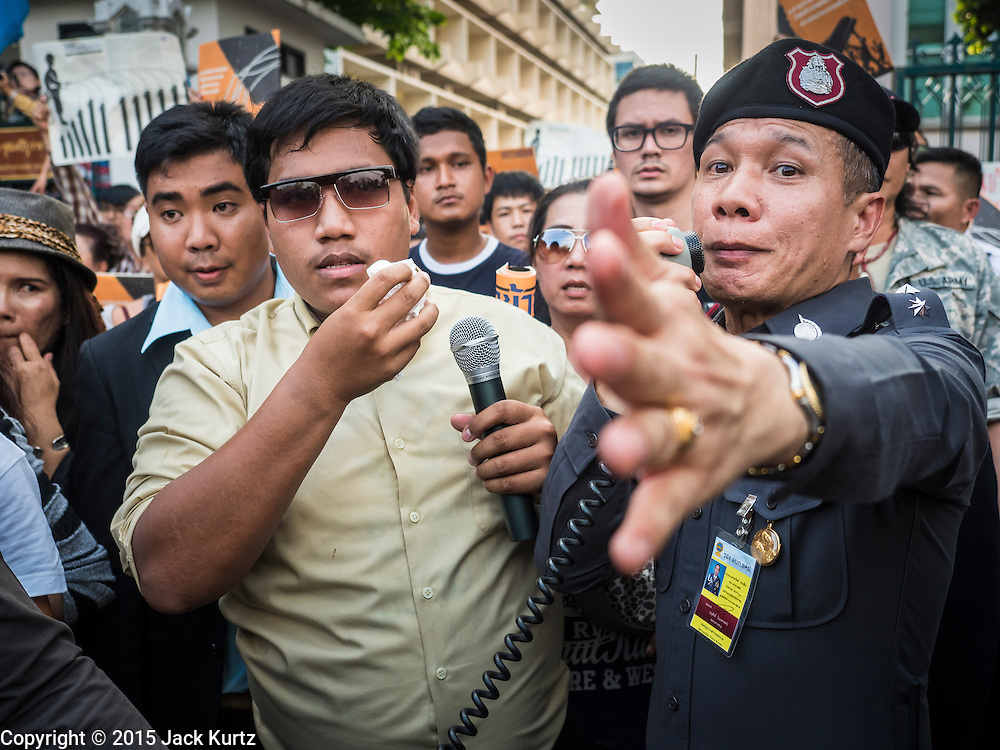 19 SEPTEMBER 2015 - BANGKOK, THAILAND:  Student activist SIRIWIT SERITHIWAT (left)   and Thai Police Colonel ATHAWIT SAISUB negotiate a route out of Thammasat University to Democracy Monument. Hundreds of people protested against Thailand's military dominated government Saturday. The protest started with seminar about the 2006 coup that deposed popularly elected former Prime Minister Thaksin Shinawatra. After the seminar activists marched from Thammasat University to Democracy Monument, about 1 mile. Political gatherings of more than 5 people are banned by Thailand's military government and police tried to dissuade the protestors from finishing their march. Protestors ignored the police, who then stood by and watched but made no effort to intervene. At Democracy Monument protestors laid flowers and made speeches against the military. It was the largest anti-coup protest in Bangkok in more than a year.   PHOTO BY JACK KURTZ
