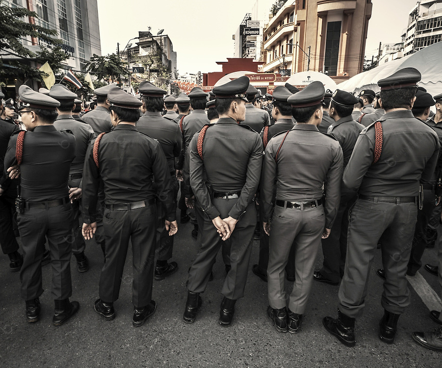 Policemen at Yaowarat Road in charge for security during the celebration of the Chinese New Year in Chinatown Bangkok Thailand