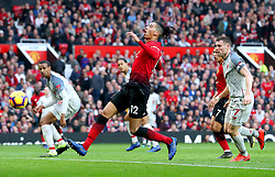 Manchester United's Chris Smalling (centre) has a shot on goal but misses during the Premier League match at Old Trafford, Manchester.