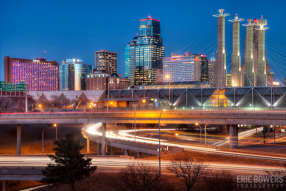 Downtown Kansas CIty, Missouri skyline and highway loop traffic motion blur and light trails at dusk, taken from near 16th & Jefferson Streets.