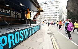 Prostate Cancer UK members cheer on runners during the 2018 London Landmarks Half Marathon.