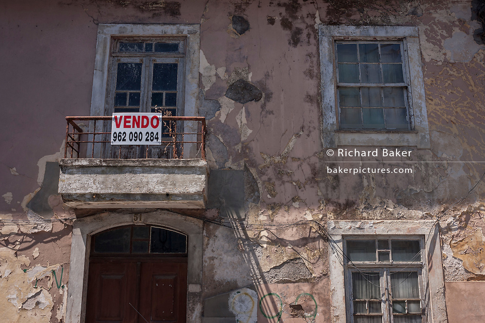 Derelict town house on sale in the spa resort of Luso, Portugal.