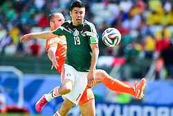 29.06.2014, Castelao, Fortaleza, BRA, FIFA WM, Niederlande vs Mexico, Achtelfinale, im Bild Oribe Peralta (Mexiko) gegen Ron Vlaar (Niederlande) // during last sixteen match between Netherlands and Mexico of the FIFA Worldcup Brazil 2014 at the Castelao in Fortaleza, Brazil on 2014/06/29. EXPA Pictures © 2014, PhotoCredit: EXPA/ fotogloria/ Best Photo Agency<br /> <br /> *****ATTENTION - for AUT, FRA, POL, SLO, CRO, SRB, BIH, MAZ only*****