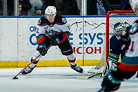KELOWNA, BC - MARCH 6: Pavel Novak #11 of the Kelowna Rockets skates from behind the net with the puck and attempts a wrap around goal against Roddy Ross #1 of the Seattle Thunderbirds at Prospera Place on March 6, 2020 in Kelowna, Canada. (Photo by Marissa Baecker/Shoot the Breeze)