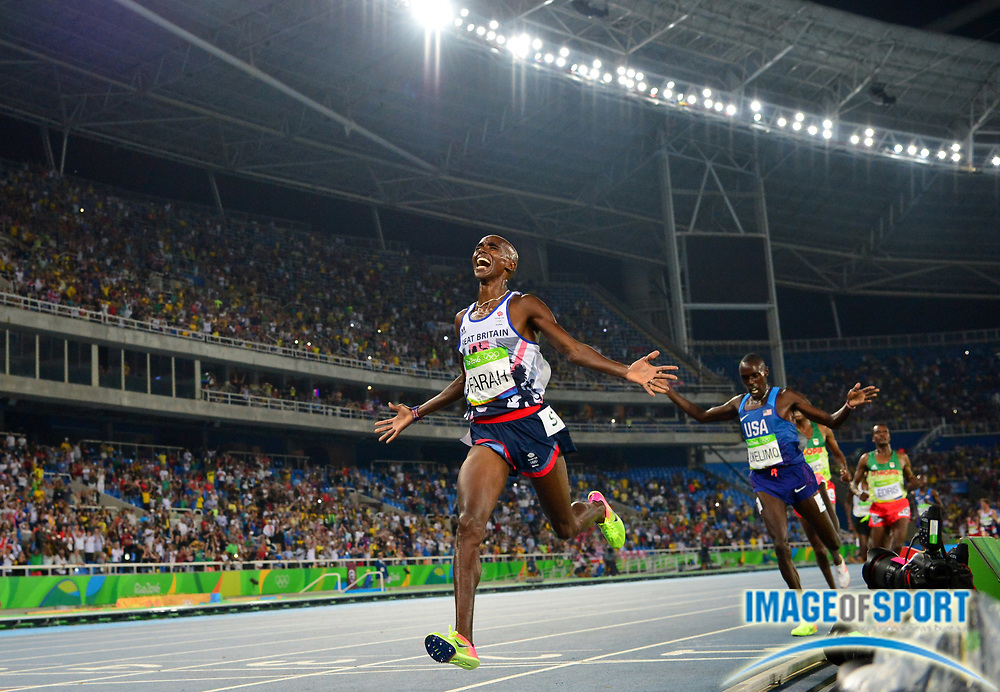 Aug 20, 2016; Rio de Janeiro, Brazil; Mo Farah aka Mohamed Farah (GBR) celebrates after defeating Paul Chelimo (USA) to win the 5,000m in 13:03.30 during the 2016 Rio Olympics at Estadio Olimpico Joao Havelange. <br /> <br /> *