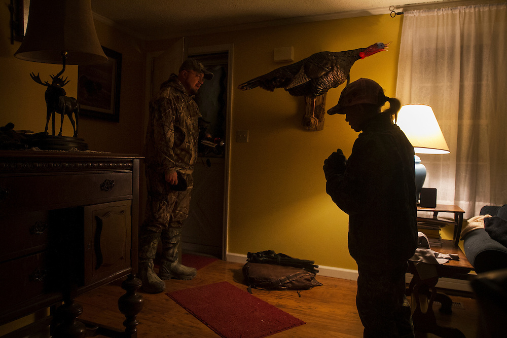 Brett Ladeau, 44, of Hartland, left, opens the front door of his home for his daughter Sydney Ladeau, 10, around 4 a.m. to go out for youth turkey opener on April 28, 2012.
