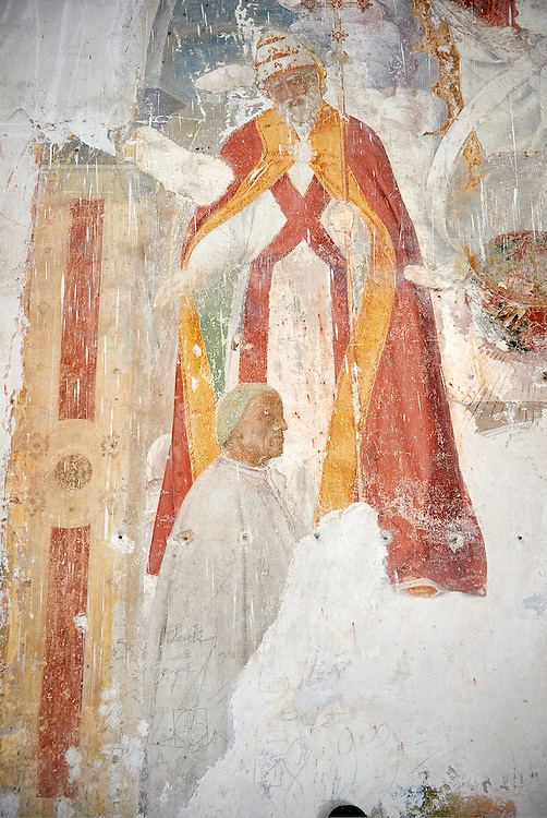 Fresco of the person who commissioned the church genuflecting inside the 12th century Romanesque facade of the Chiesa di San Pietro extra moenia (St Peters), Spoletto, Italy .<br /> <br /> Visit our ROMANESQUE SCULPTURE PHOTO COLLECTION for more   photos  to download or buy as prints https://funkystock.photoshelter.com/gallery/Romanesque-Statue-Sculptures-Pictures-Images/G0000ezFHYeF_xRI/C0000YpKXiAHnG2k<br /> If you prefer to buy from our ALAMY PHOTO LIBRARY  Collection visit : https://www.alamy.com/portfolio/paul-williams-funkystock/pietro-extra-moenia-spoleto.html .<br /> <br /> Visit our MEDIEVAL PHOTO COLLECTIONS for more   photos  to download or buy as prints https://funkystock.photoshelter.com/gallery-collection/Medieval-Middle-Ages-Historic-Places-Arcaeological-Sites-Pictures-Images-of/C0000B5ZA54_WD0s