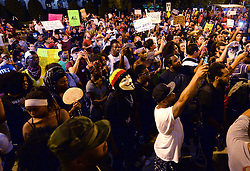 Protesters congregate outside the police department Saturday, September 24, 2016 in Charlotte, NC, USA. Protesters came together for the fifth straight night to protest following the fatal shooting of Keith Lamont Scott. Keith Lamont Scott was shot and killed by Charlotte-Mecklenburg Police Officer Brentley Vinson on Tuesday afternoon. Photo by Jeff Siner/Charlotte Observer/TNS/ABACAPRESS.COM