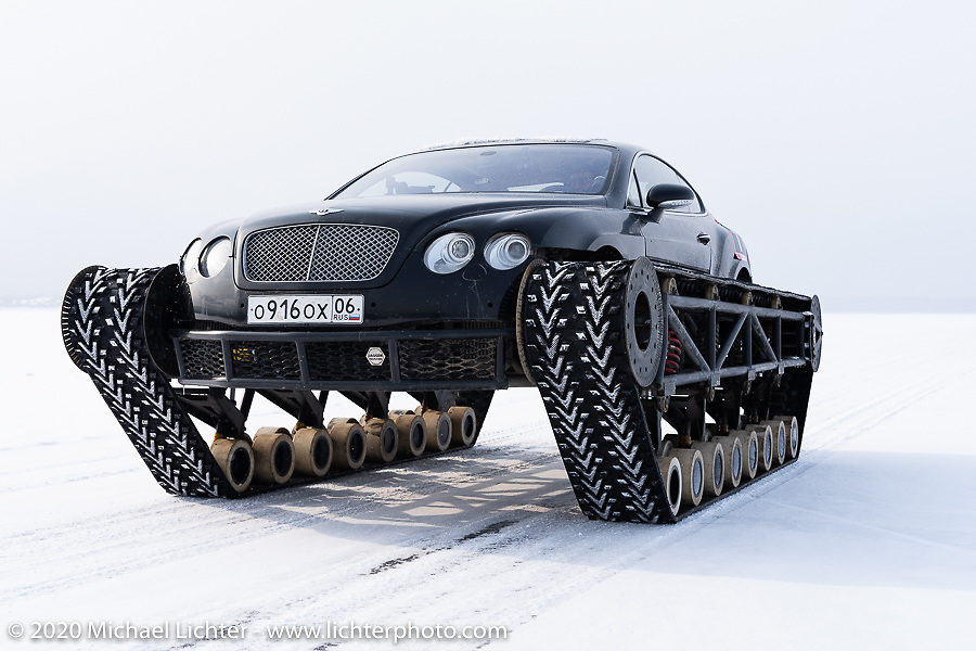 Academeg (Konstantin Zarucki), a YouTuber with 4.3 million subscribers driving his Bentley Continental Ultratank, a Continental (new Continentals start at $202,000!) that he modified with winter tracks for the Baikal Mile Ice Speed Festival. Maksimiha, Siberia, Russia. Thursday, February 27, 2020. Photography ©2020 Michael Lichter.