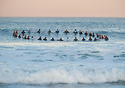 Surfers paddle out to honor the one year anniversary of the death of Andy Irons, before the Rip Curl Pro Search surf contest at Ocean Beach, San Francisco, California on November 2, 2011