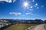 USA, Colorado, Rocky Mountain National Park,  a young girl makes a photograph from an overlook along Trail Ridge Road