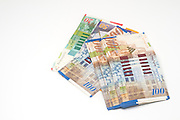 Israeli currency, NIS, New Israeli Sheqalim, on white background bank notes of 100, 50 and 20 NIS