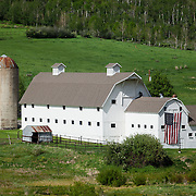 The McPolin Barn was purchased by the citizens of Park City in 1990 to enhance the entrance corridor and maintain open space. In the summer, a large American Flag adds to the heritage of this iconic spot.