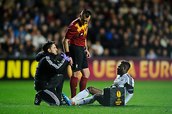 Swansea Midfielder Nathan Dyer (ENG) lays on the ground holding his leg - Photo mandatory by-line: Rogan Thomson/JMP - Tel: 07966 386802 - 20/02/2014 - SPORT - FOOTBALL - Liberty Stadium, Swansea -  Swansea City v SSC Napoli - UEFA Europa League, Round of 32, First Leg.